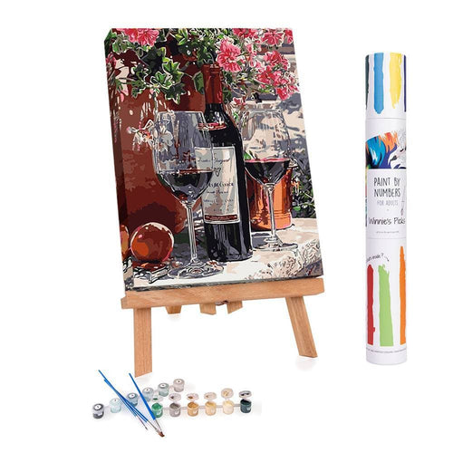 Paint by numbers of a red wine bottle and two glasses