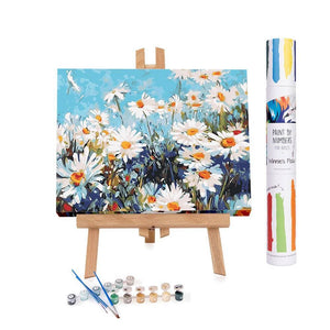 Adults paint by numbers of a field of daisies