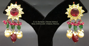Traditional Gold and Diamond Polki rhodo-center star-shaped Pendant Set with rubies and pearls - G. K. Ratnam