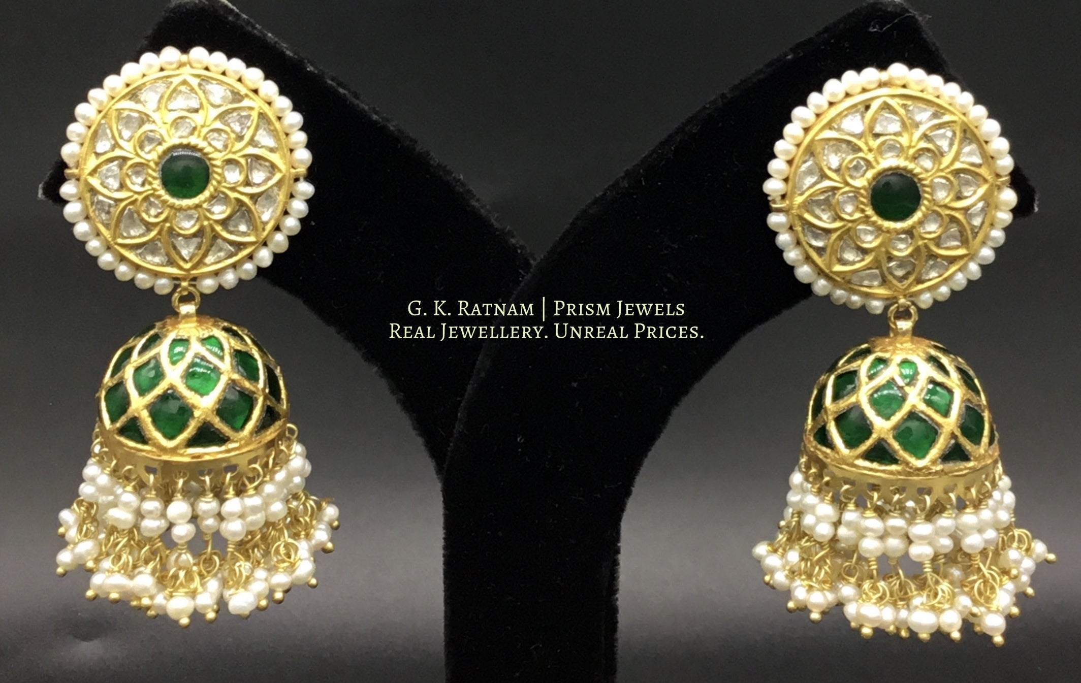 23k Gold and Diamond Polki Jhumki Earrings set with emerald-green stones and enhanced with Freshwater Pearls