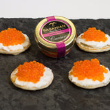 Smoked trout serving example: Blinis and creme fraiche