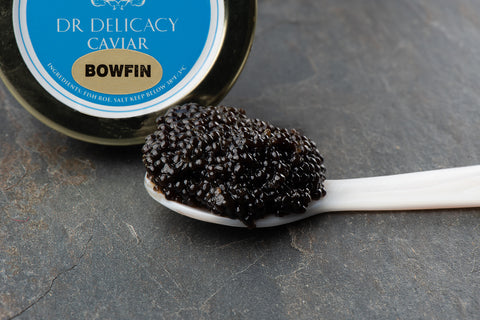 Bowfin Caviar on the mother of pearl caviar spoon with lid