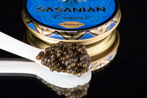 Russian caviar on the mother of pearl spoon and sasanian case in the background