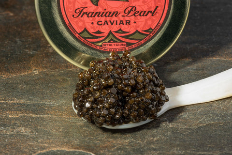 A spoonful of Caspian Baerii 000 caviar on a mother of pearl spoon