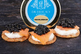 Hackleback caviar on blini, creme fraiche and smoked salmon.