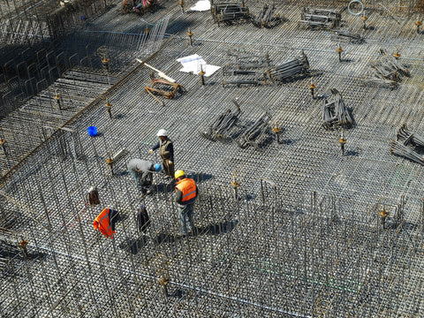 construction site with worker wearing hi vis