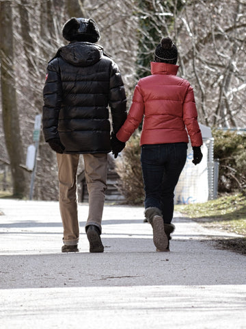 couple walking on winter hand in hand