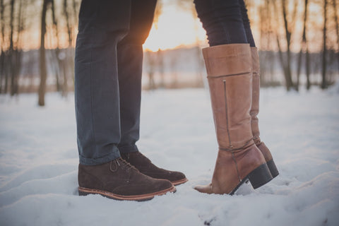feet of man in shoes and woman in boots