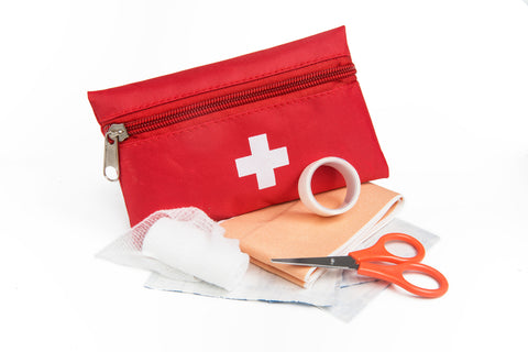 first aid kit pouch with scissors, bandages and gauze