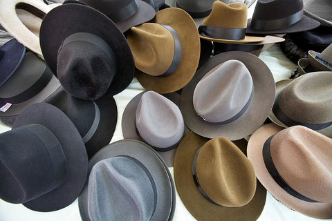 hats of different colors and sizes