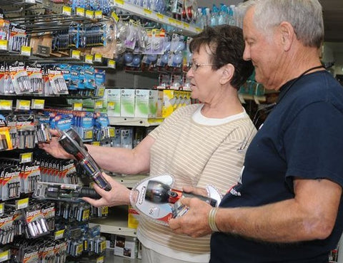 man and woman choosing an emergency flashlight