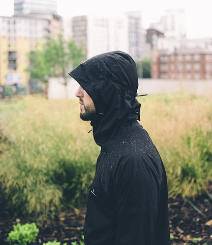 man wearing raincoat on sideview