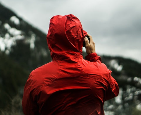 man wearing red raincoat