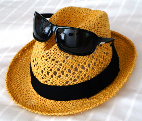 straw hat with summer sunglasses
