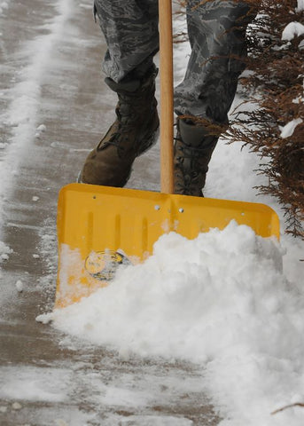 yellow snow shovel