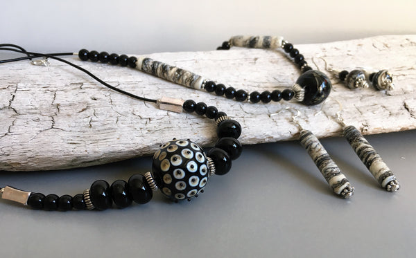 Fashion accessories. Jewelry collection in black and white. Handmade jewelry from handmade glass beads