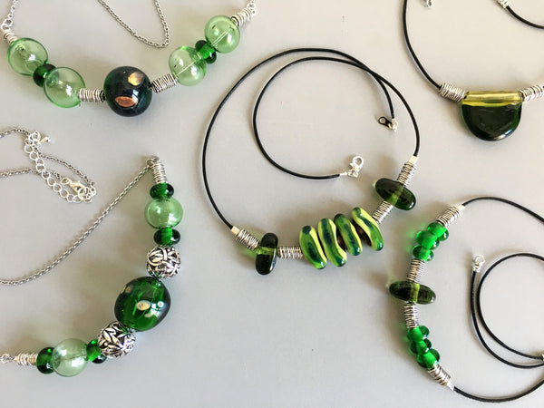 Jewelry collection in green. Handmade glass beads Venetian style in fashion accessories