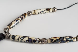 Unusual design necklace with handmade beads