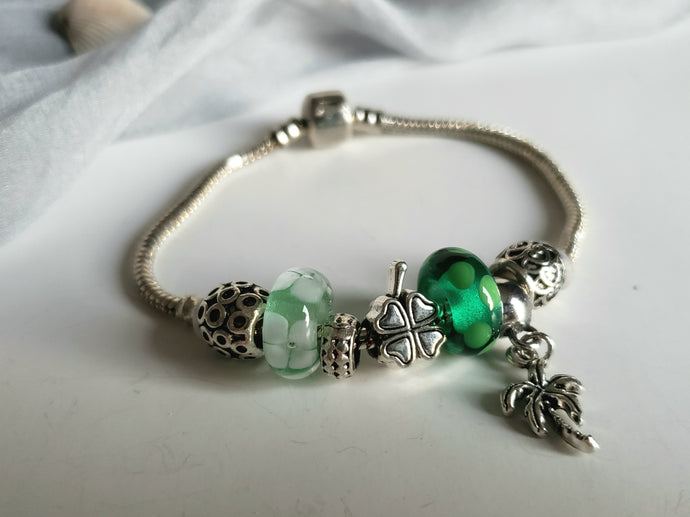 Pandora style bracelet with green handmade glass beads.