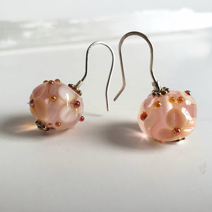 Gorgeous floral drop earrings in pale pink color