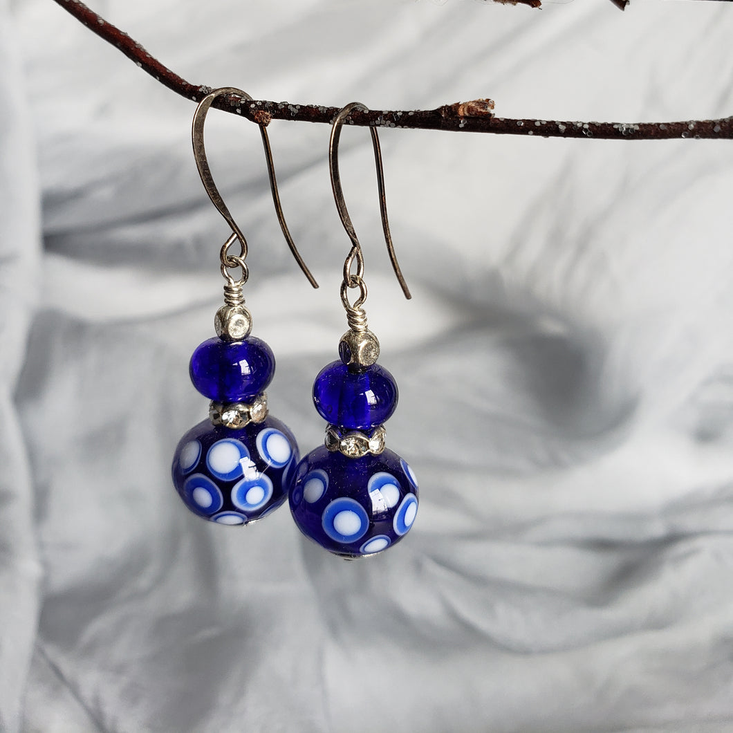 Folk style earrings in deep cobalt and white color