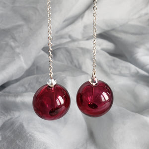 Contemporary hollow glass long dangle earrings in ruby color
