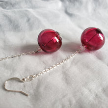 Modern stylish earrings with blown glass beads  in ruby color