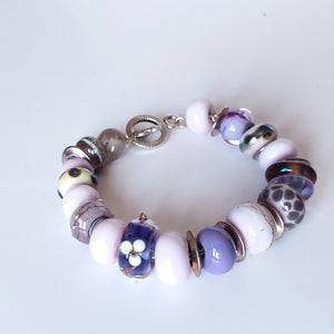 Purple and lilacs beaded bracelet for special occasion
