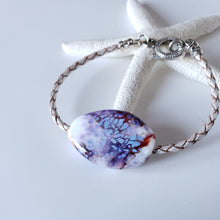Braided leather bracelet with large bead in white and purple.