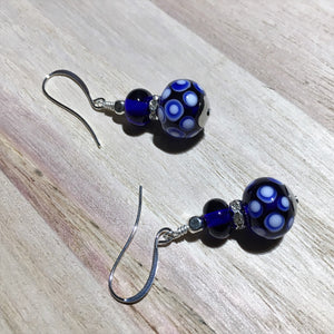 Blue and white color earrings in traditional style