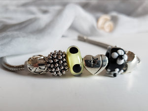 Funky handmade Pandora style bracelet in black and silver.