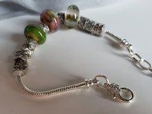 Pandora style bracelet with mystic pastel colored beads.