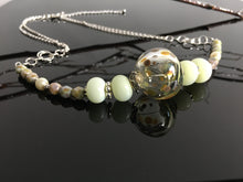 Handmade glass beads necklace with focal polka dots bead and pale green beads