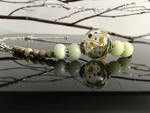 Handmade hollow glass bead in polka dots
