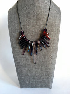 Contemporary statement necklace  in rich gorgeous purple transparent glass.