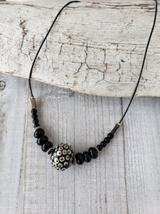Modern statement necklace  from handmade hollow glass bead.