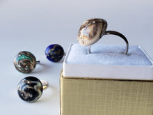 Modern rings handmade from glass decorated with silver