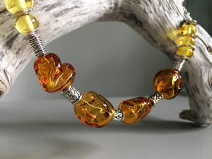 Unique amber necklace handmade from glass blown beads