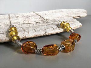 Amber color necklace with handmade glass beads