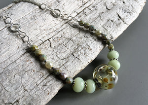 Handcrafted glass beads in the necklace design