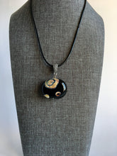 Modern and edgy hollow glass pendant