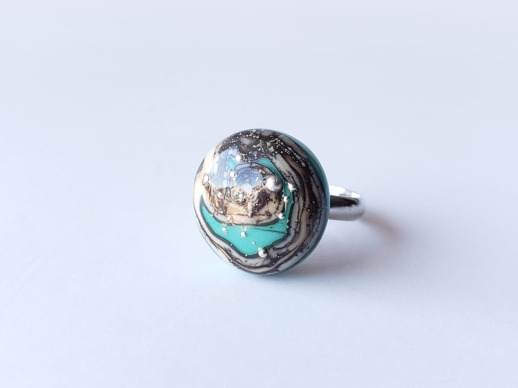 Classy artisan ring in turquoise color made from glass