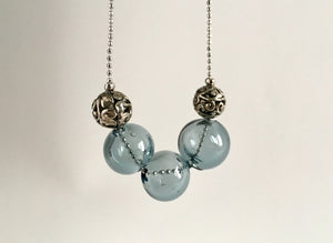 Modern necklace with hand blown glass beads