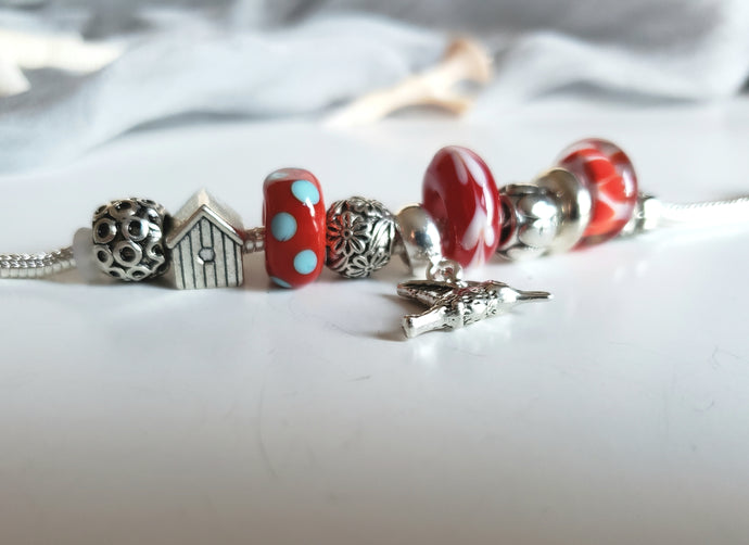 Polka dots Pandora style bracelet with handmade bead in red color.