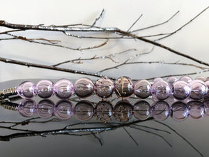 Purple and lilac transparent glass blown beads