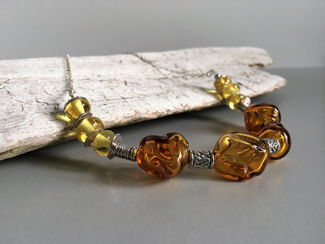 Beautiful glass beads necklace in amber color