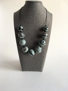 Modern and striking necklace of large hollow glass beads.