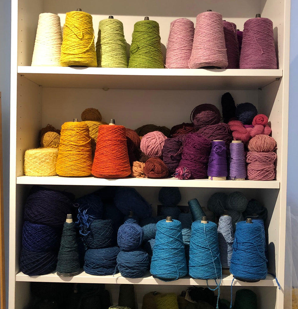 colorful yarns on shelf from green mountain spinnery