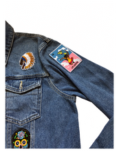 Load image into Gallery viewer, Ethnic cultural patch on light wash denim. The culture is in 1 jacket.
