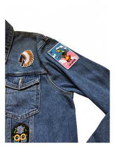 Ethnic cultural patch on light wash denim. The culture is in 1 jacket.